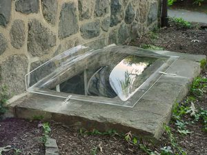 Window Well Cover for Masonry or Wood Wells: Model 2-R stone wall