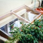 9 Ways to Include Your Window Well in Your Garden and Landscaping